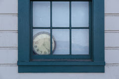 Old Clock behind Window Royalty Free Stock Image