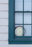 Old Clock behind Window Stock Photography