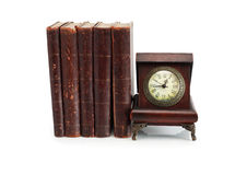Old Clock And Books Stock Photo