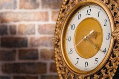 Old clock bricks wall Stock Photos