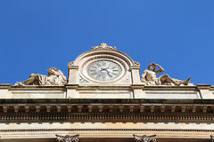 Old clock on a building in Milan, Italy. Old clock on a building in Milan Stock Images