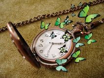 Old clock with butterflies Royalty Free Stock Photos