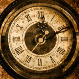 Old clock with chain lying on rough green surface Royalty Free Stock Images