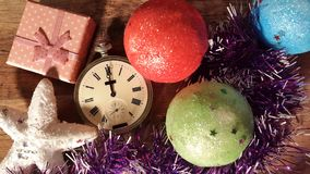 Old clock among the Christmas presents show midnight Royalty Free Stock Photo