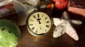 Old clock among the Christmas presents show midnight Stock Photography