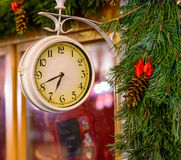 Old clock with Christmas tree decoration. In Riga, Latvia Royalty Free Stock Images
