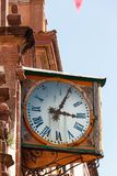 Old clock on a church facade Stock Images