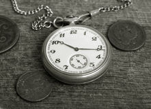 Old clock and coins Royalty Free Stock Photography