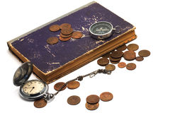 Old clock, compass, book  and coins Stock Photos