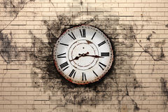 Old clock. 3d rendering of an old clock on a brick wall Royalty Free Stock Image