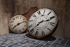 Old clock. 3d rendering of an old clock on a dirty and old wall Royalty Free Stock Images