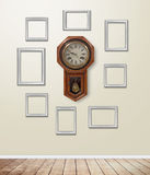 Old clock decor on wallpaper with light flare. Stock Images
