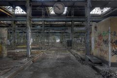 Old clock in a deserted hall Stock Image
