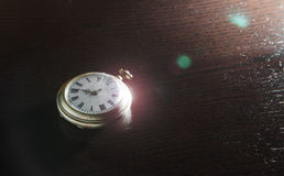 Old watches on the desk. Old silver pocket watches placed on the dark wooden table Stock Images