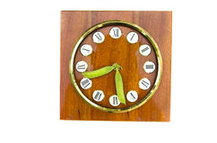 Old clock dial with fresh pea pods arrows Royalty Free Stock Photo