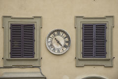 Old clock on a facade Stock Photo