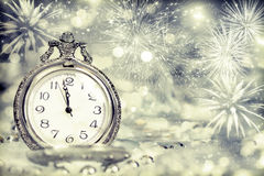 Old clock with fireworks and holiday lights Royalty Free Stock Image