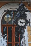 Old clock. In front of a train station Royalty Free Stock Photography