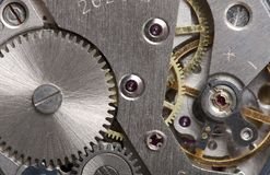Old clock gear mechanism. Of the background Stock Photos