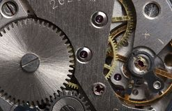 Old clock gear mechanism. Of the background Stock Images