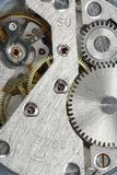 Old clock gear mechanism. Of the background Stock Photo