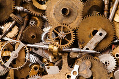 Old clock gears cogwheels macro view. Steampunk mechanical equipment and mechanism background. Shabby grunge scratch Stock Photos
