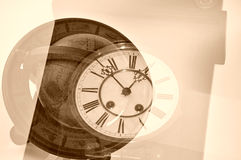 Old clock and globe. Stock Photos