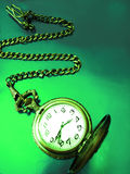Old clock on green color Stock Photography