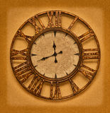 The old clock on the grunge background. Time stopped Stock Image