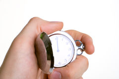 Old clock in the hand Stock Images