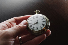 Old watches in hand. Old silver pocket watches in mens hand Stock Image