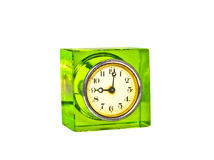 Old clock isolated on white background. Square antique watch in transparent green body on white Royalty Free Stock Photos