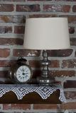 Old clock and lamp. Old clock and a lamp Royalty Free Stock Image