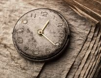 Old clock on a manuscript book Royalty Free Stock Image
