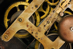 Old clock mechanism close up. Old brass clock mechanism background Stock Image