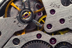 Old clock mechanism. With gears and cogs. Macro photo; Abstract background; Closeup view Royalty Free Stock Image