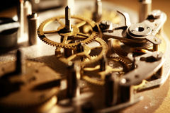 Old Clock Mechanism. Machinery concept. Gears connection in old clock mechanism Royalty Free Stock Image