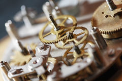 Old Clock Mechanism. Machinery concept. Gears connection in old clock mechanism Royalty Free Stock Images
