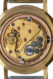 Old clock mechanism macro shot, top view. Isolated over white Stock Photos