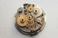 The old clock mechanism with metal gears and screws Royalty Free Stock Photography