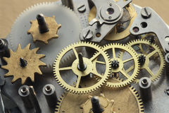 The old clock mechanism with metal gears and screws Royalty Free Stock Photo
