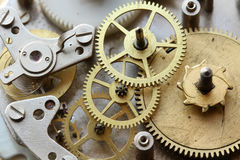 The old clock mechanism with metal gears and screws Stock Images