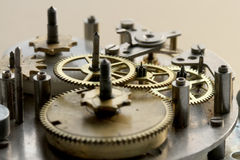 The old clock mechanism with metal gears and screws Royalty Free Stock Image