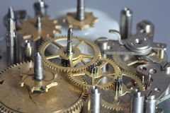 The old clock mechanism with metal gears and screws Stock Photos