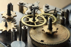 The old clock mechanism with metal gears and screws Royalty Free Stock Photos