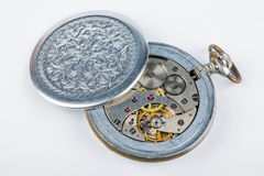 Old clock mechanism. Open old clock mechanism on white background Royalty Free Stock Photo