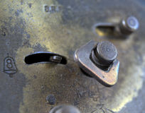 Old clock mechanism. Picture of an alarm  Old clock mechanism Royalty Free Stock Images