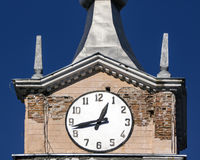 Old clock of the old tower. Retro tower of post office in russian city Royalty Free Stock Image