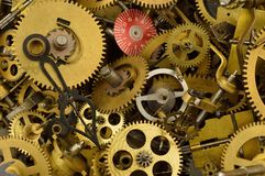 Old Clock Parts. Pile of jumbled up dusty old clock parts Stock Photo