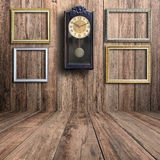 Old clock and picture frame Royalty Free Stock Images